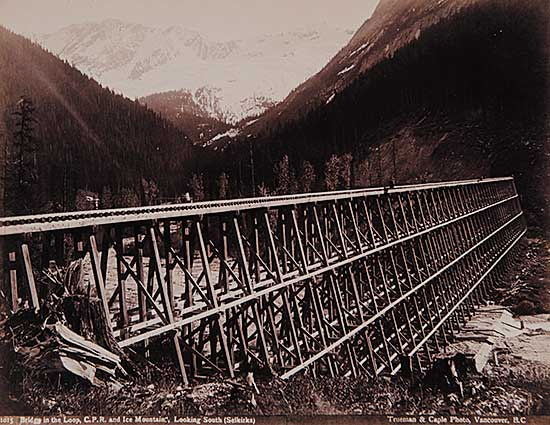 #149 ~ Trueman and Caple - 1015 - Bridge in the Loop, C.P.R. and Ice Mountains, Looking South [Selkirks]